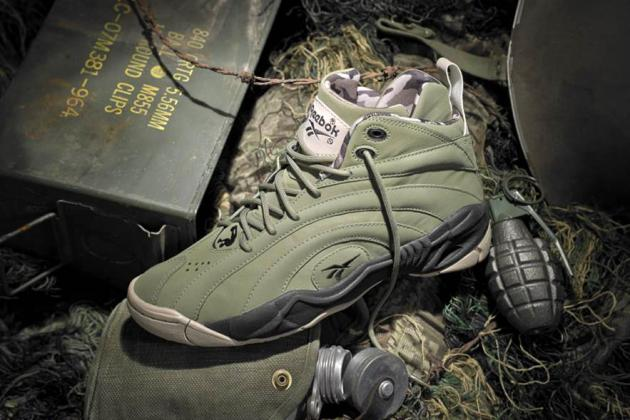 83b21fc508afe The Reebok Shaqnosis is back with an upcoming Barracks colorway. The kicks  feature a rugged cargo green upper with overlapping panels of camo collar  lining