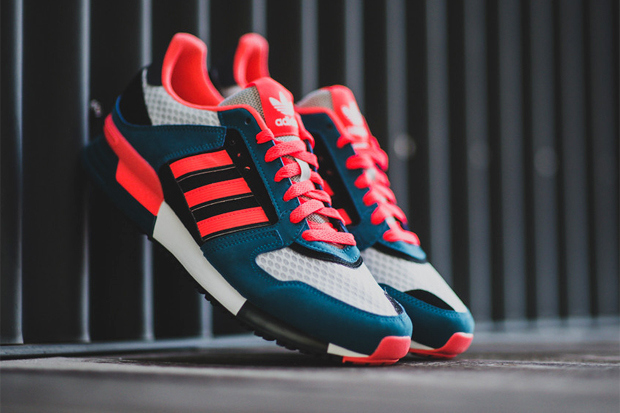 5d16bf221c640 Presenting this latest bold new colorway for the ZX 630 silhouette from adidas  Originals. The deep blue suede and grey mesh base features hits of black  and ...