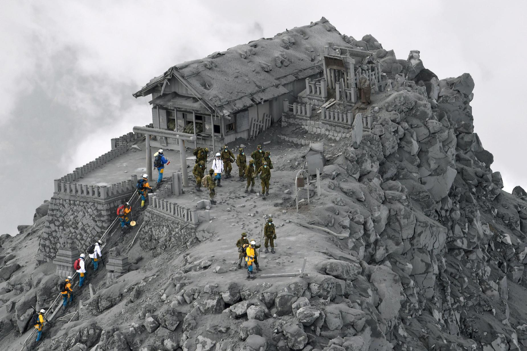 Rescuers at a shrine near the summit of Mt. Ontake, which erupted last week.