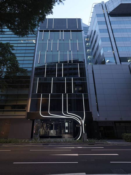 ... The Office Building Completed By Singapore Ministry Of Design. The  Building Displays Strips Of White Lighting Over The Exterior And Interior  Surfaces.